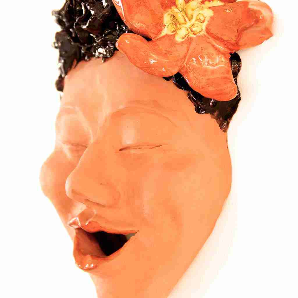 laughing face sculpture