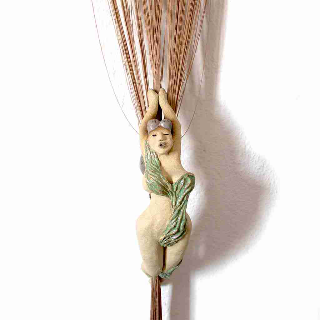 partially glazed ceramic sculpture of a silks performer
