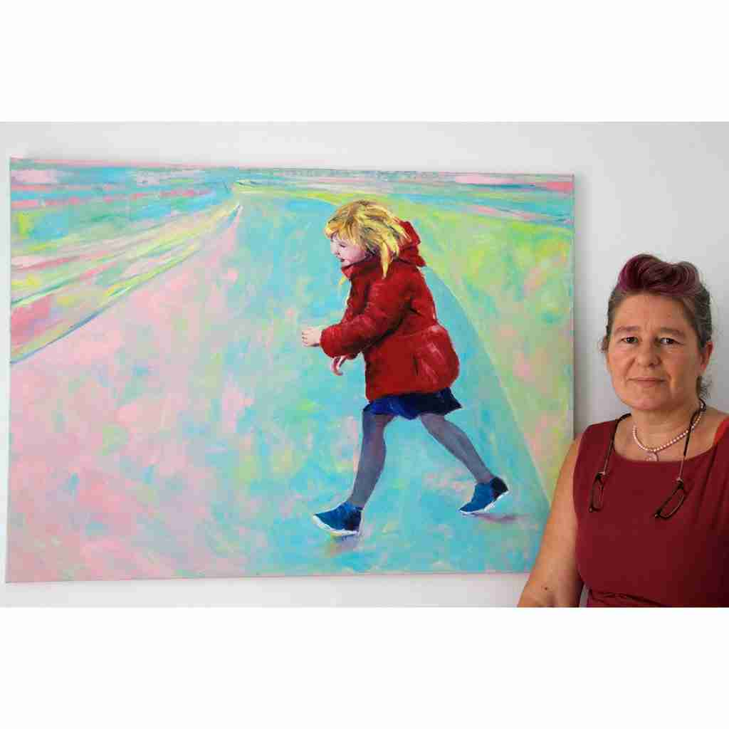Artist Emma Plunkett with a painting called Girlhood