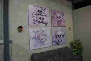 Afterlife, 4 pink skull oil paintings
