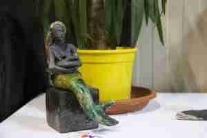 breast feeding mermaid raku fired sculpture