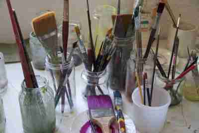 paint brushes in jars