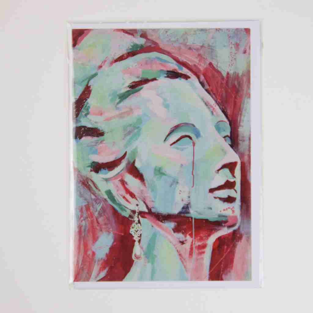Painted head of a beautiful woman, red and turquoise.
