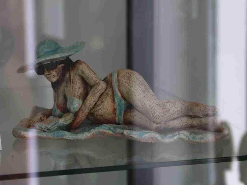 stoneware clay sun bather sculpture