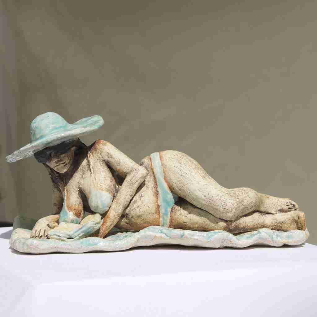stoneware sculpture of a sunbather