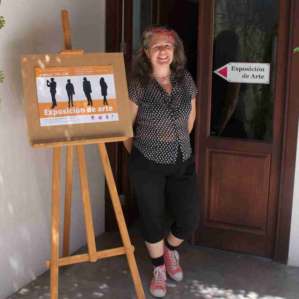 Emma Plunkett at entrance to the art exhibition