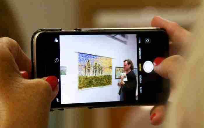 oil painting through a camera screen at an exhibition